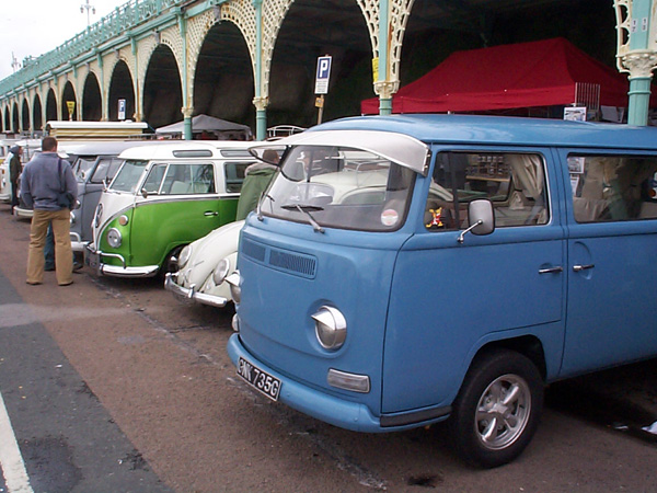 Row of vans and a Beetle