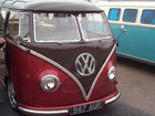 Gorgeous dark brown over red metallic split window camper