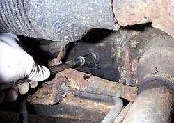 Removing gearbox oil filler bolt